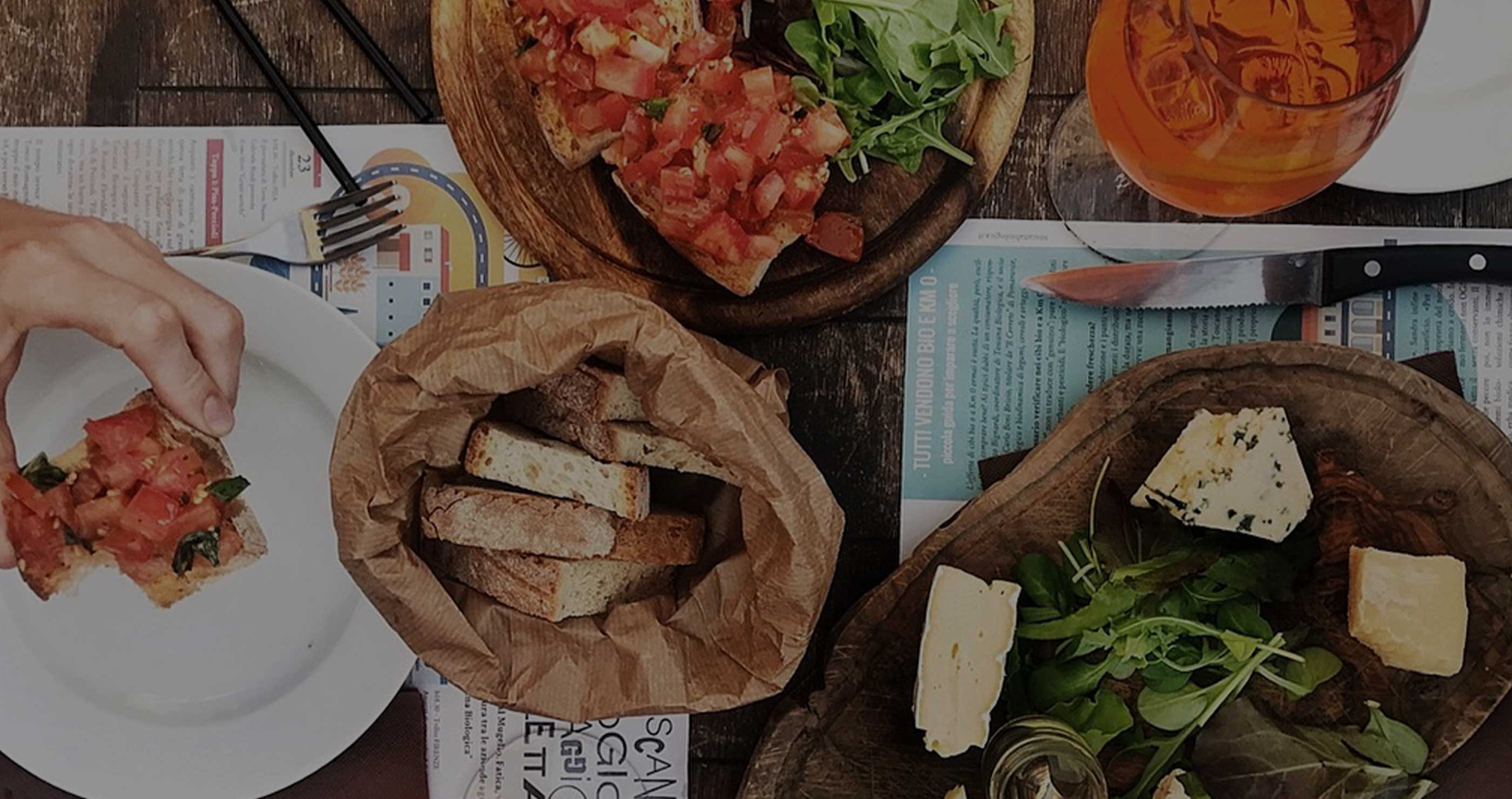 Table with artisinal bread and bruschetta by Diala's Kitchen